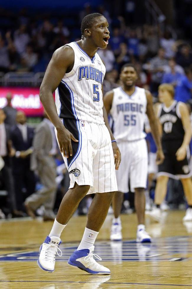 Orlando Magic's Victor Oladipo (5) reacts to the fans after dunking the ball on a fast break against the Brooklyn Nets during the second half of an NBA basketball game in Orlando, Fla., Sunday, Nov. 3, 2013. Orlando Magic won 107-86