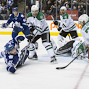 Toronto Maple Leafs' James van Riemsdyk, left, falls on the ice after his shot is saved by Dallas Stars goaltender Kari Lehtonen during the second period of an NHL hockey game, Tuesday, Dec. 2, 2014 in Toronto The Associated Press