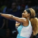 Serena Williams of the U.S. acknowledges the crowd after defeating Eugenie Bouchard of Canada during their WTA Finals singles tennis match at the Singapore Indoor Stadium October 23, 2014. REUTERS/Edgar Su
