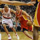 Houston Rockets' Chandler Parsons (25) drives against Portland Trail Blazers' Nicolas Batum (88) during the first half of an NBA basketball game in Portland, Ore., Thursday Dec. 12, 2013 The Associated Press