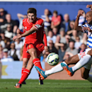 Liverpool's Steven Gerrard, centre, shoots during the English Premier League soccer match between Liverpool and Queens Park Rangers, at Loftus Road, London, Sunday, Oct. 19, 2014