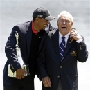 Tiger Woods, left, jokes with Arnold Palmer after winning the Arnold Palmer Invitational golf tournament, Monday, March 25, 2013, in Orlando, Fla. (AP Photo/John Raoux)