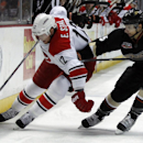 Carolina Hurricanes center Eric Staal (12) controls the puck against Anaheim Ducks defenseman Luca Sbisa (5), of Italy, during the first period of an NHL hockey game Sunday, March 2, 2014, in Anaheim, Calif The Associated Press