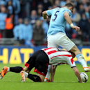 Sunderland's Jack Colback, left, vies for the ball with Manchester City's Pablo Zabaleta, right, during their English League Cup final soccer match at Wembley Stadium, London, England, Sunday, March 2, 2014