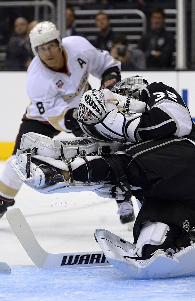 Los Angeles Kings goalie Jonathan Quick, right, stops a shot by Anaheim Ducks right wing Teemu Selanne, rear, during the first period of an NHL preseason hockey game, Tuesday, Sept. 24, 2013, in Los Angeles