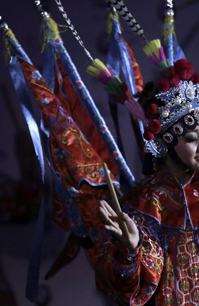 A Beijing Opera artist performs during a photo call ahead of the Masters golf tournament in Shanghai, China, Tuesday, Oct. 22, 2013.  The Masters will begin on Oct. 24 at the Lake Malaren Golf Club