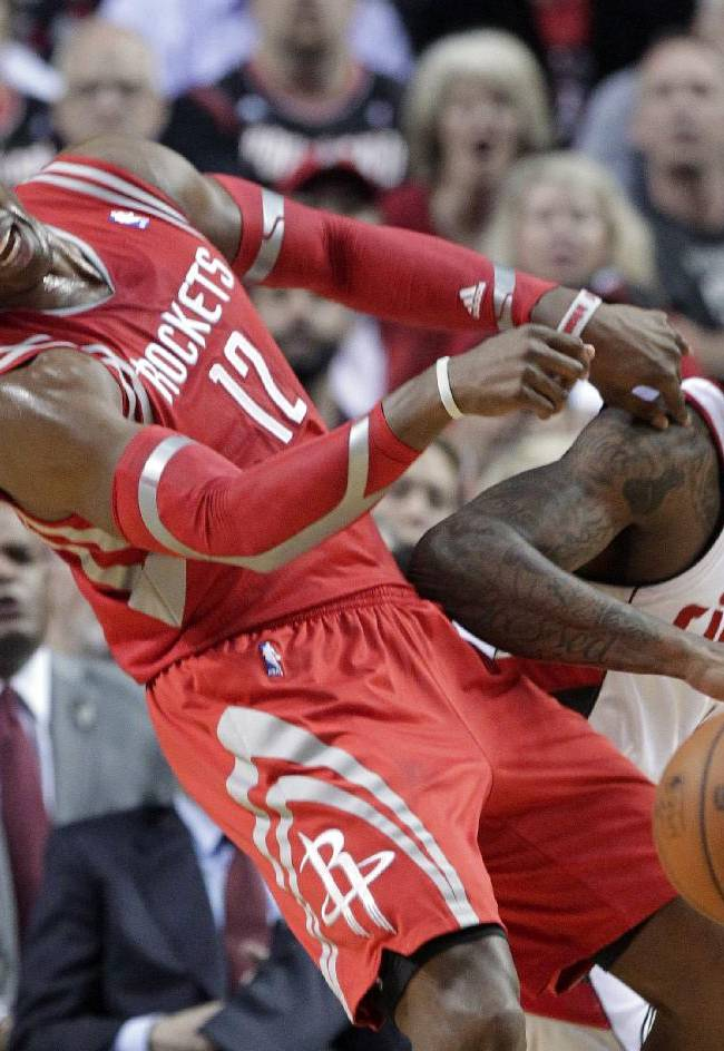 Houston Rockets center Dwight Howard, left, and Portland Trail Blazers forward Dorell Wright collide during the first half of Game 3 of an NBA basketball first-round playoff series in Portland, Ore., Friday, April 25, 2014