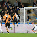 Hull City's Danny Graham, centre, scores his team's opening goal during their English Premier League match against Swansea City at the Liberty Stadium, Swansea, Wales, Monday, Dec. 9, 2013