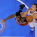 Los Angeles Clippers forward Blake Griffin, right, puts up a shot as Milwaukee Bucks forward Jeff Adrien defends during the first half of an NBA basketball game, Monday, March 24, 2014, in Los Angeles The Associated Press