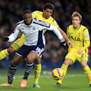 West Bromwich Albion's Victor Anichebe, center, and Tottenham Hotspur's Paulinho battle for the ball during their English Premier League soccer match at The Hawthornes, Birmingham, England, Saturday, Jan. 31, 2015