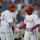 Philadelphia Phillies' Jimmy Rollins, right, is greeted by Marlon Byrd after he scored on a single by Ryan Howard during the fourth inning of a baseball game against the Los Angeles Dodgers on Wednesday, April 23, 2014, in Los Angeles The Associated Press
