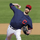 Cleveland Indians relief pitcher John Axford delivers against the Milwaukee Brewers in the seventh inning of a spring training exhibition baseball game Sunday, March 9, 2014, in Goodyear, Ariz The Associated Press