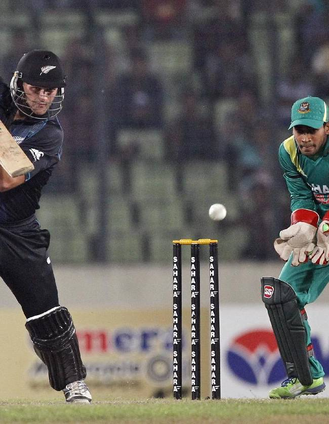 New Zealand's Corey Anderson bats, as Bangladesh's captain Mushfiqur Rahim cups his hands to catch the ball during the first one-day international cricket match in Dhaka, Bangladesh, Tuesday, Oct. 29, 2013