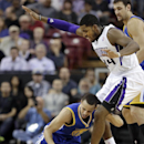 Golden State Warriors guard Stephen Curry, left, goes to his knees with the ball against Sacramento Kings forward Jason Thompson during the third quarter of an NBA basketball game in Sacramento, Calif., Sunday, Dec. 1, 2013. The Warriors won 115-113 The A