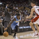 Denver Nuggets' Nate Robinson, left, drives past Toronto Raptors' Tyler Hansbrough during the second half of an NBA basketball game on Sunday, Dec. 1, 2013, in Toronto The Associated Press