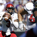 In this Sept. 6, 2014, file photo, Eastern Washington quarterback Vernon Adams Jr.,left, looks to throw against Washington during the second half of an NCAA football game in Seattle. Adams, one of the best players in FCS, is considering a transfer to Oreg