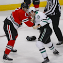 Chicago Blackhawks left wing Patrick Sharp, left, fights with Dallas Stars center Shawn Horcoff, right, during the second period of an NHL hockey game in Chicago, Sunday, Jan. 18, 2015 The Associated Press