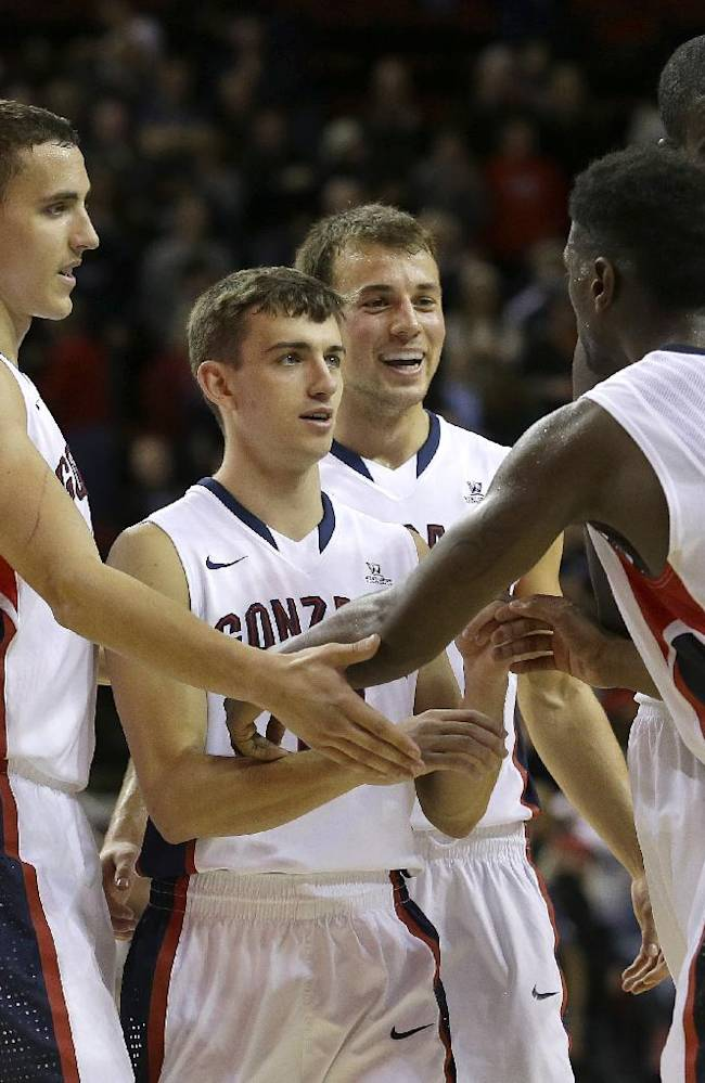Gonzaga's Gary Bell, Jr., (5) is greeted by teammates (from left) Kyle Dranginis, David Stockton, Kevin Pangos, and Sam Dower after Gonzaga beat South Alabama 68-59 in an NCAA college basketball game, Saturday, Dec. 14, 2013, in Seattle