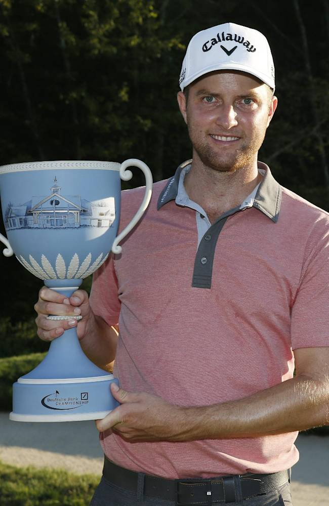In this Sept. 1, 2014, file photo, Chris Kirk holds the trophy after winning the Deutsche Bank Championship golf tournament in Norton, Mass. Ryder Cup captain Tom Watson announces his wild-card selections for the American team, Tuesday, Sept. 2, 2014, with Keegan Bradley, Hunter Mahan, Webb Simpson and Chris Kirk among the favorites