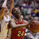 Hartford forward Ruthanne Doherty (24) shoots in front of Albany forward Julie Forster (11) during the first half of their NCAA college basketball game in the championship of the America East Conference tournament on Saturday, March 16, 2013, in Albany, N.Y. (AP Photo/Mike Groll)