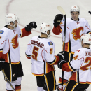 Calgary Flames defenseman Mark Giordano (5) is congratulated by defenseman T.J. Brodiein (7), center Sean Monahan (23), and left wing Jiri Hudler (24), of the Czech Republic, after Giordano scored against the Nashville Predators in the second period of an