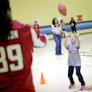 Atlanta Falcons' Steven Jackson, left, throws a ball to Shiloh Point Elementary School student Harper Mason as part of the NFL's Play 60 Campaign to encourage kids to get 60 minutes of exercise a day, Tuesday, Dec. 3, 2013, in Cumming, Ga. Jackson address