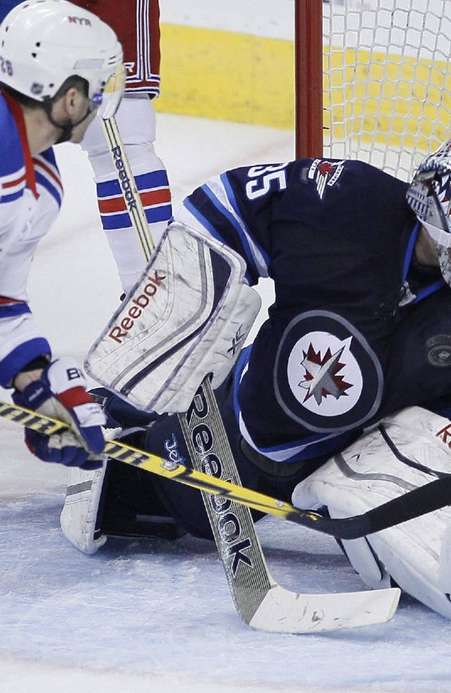 Winnipeg Jets goaltender Al Montoya (35) saves the shot from New York Rangers' Martin St. Louis (26) during first period NHL action in Winnipeg on Friday, March 14, 2014