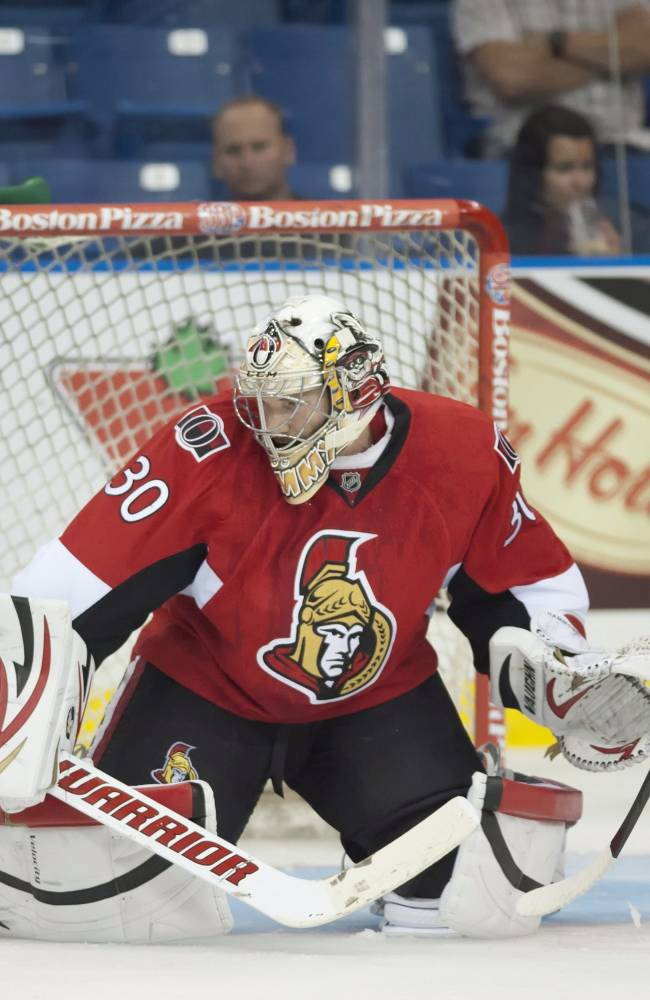 Ottawa Senators goalie Andrew Hammond makes a pad save on a shot from Calgary Flames forward Blair Jones during the third period of an NHL preseason action on Monday, Sept 16, 2013 in Saskatoon, Saskatchewan. The Senators defeat the Flames 4-2