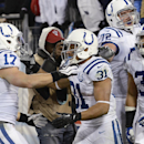 Indianapolis Colts running back Donald Brown (31) is congratulated by Griff Whalen (17), Jeffrey Linkenbach (72) and Stanley Havili (39) after Brown scored a touchdown on an 11-yard run against the Tennessee Titans in the fourth quarter of an NFL football