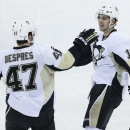 Pittsburgh Penguins' Simon Despres (47) and Brandon Sutter (16) celebrate Despres' goal against the Winnipeg Jets during the first period of an NHL hockey game Thursday, Nov. 6, 2014, in Winnipeg, Manitoba The Associated Press