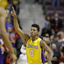 Los Angeles Lakers forward Nick Young (0) reacts after the Lakers defeated the Detroit Pistons 106-102 in an NBA basketball game at the Palace in Auburn Hills, Mich., Friday, Nov. 29, 2013 The Associated Press