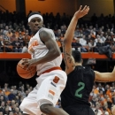 Syracuse's C.J. Fair grabds a rebound next to Notre Dame's Zach Auguste during the first half of an NCAA college basketball game in Syracuse, N.Y., Monday, Feb. 4, 2013. (AP Photo/Kevin Rivoli)