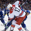 Carolina Hurricanes' Eric Staal (12) and Vancouver Canucks' Nick Bonino battle for position during the first period of an NHL hockey game, Tuesday, Oct. 28, 2014 in Vancouver, British Columbia The Associated Press