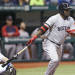 Boston Red Sox's David Ortiz follows through on a fourth-inning RBI single off Tampa Bay Rays starting pitcher Alex Cobb during a baseball game Thursday, May 16, 2013, in St. Petersburg, Fla. Shane Victorino scored on the hit. Catching for the Rays is Jose Lobaton. (AP Photo/Chris O'Meara)