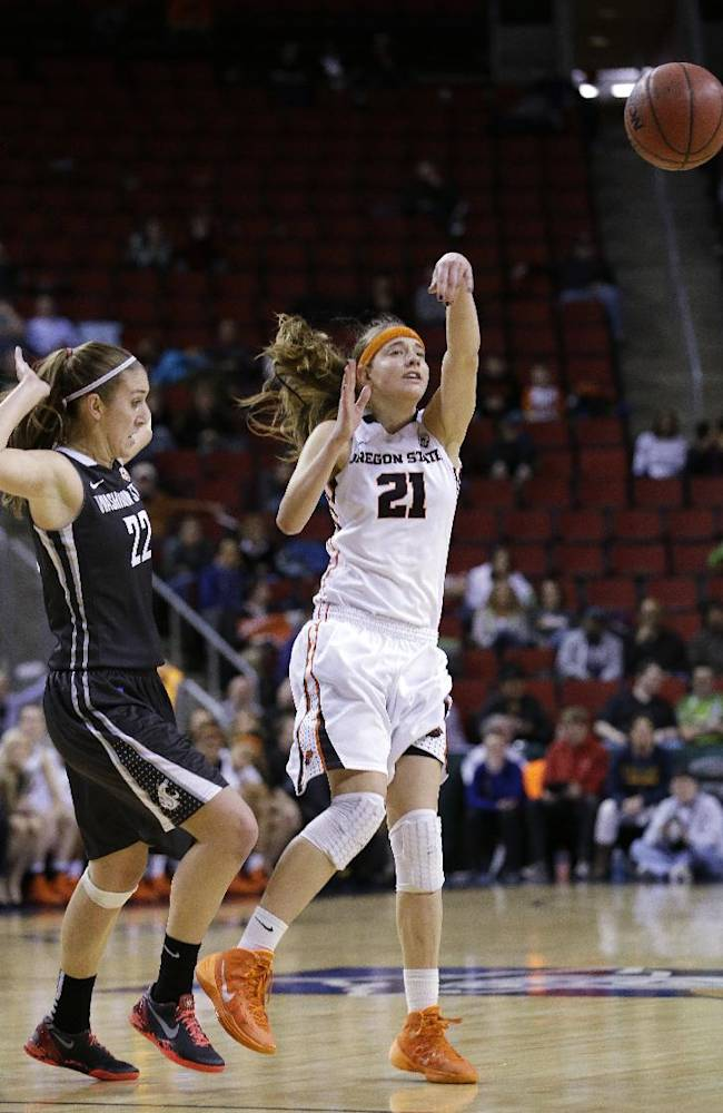 Oregon State's Sydney Wiese (21) passes in front of Washington State's Sage Romberg in the first half of an NCAA college basketball game in the Pac-12 women's tournament Saturday, March 8, 2014, in Seattle