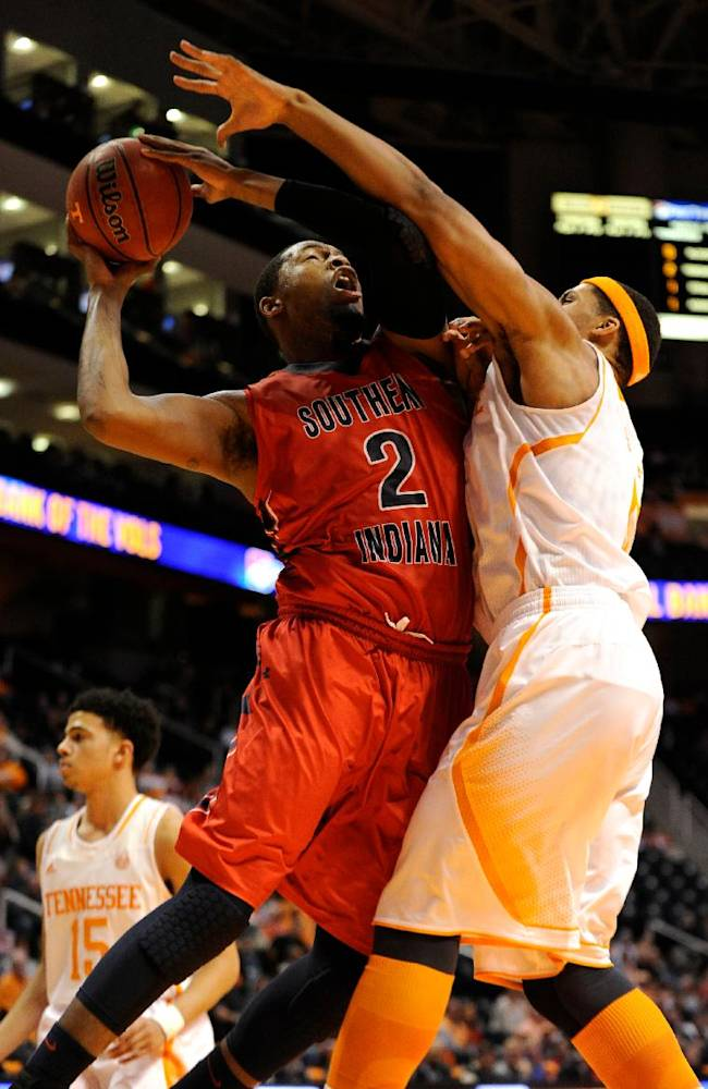 Tennessee forward Jarnell Stokes (5), right, blocks Southern Indiana forward Aaron Nelson's (2), path to the basket during the first half of an NCAA college basketball game in Knoxville, Tenn., Thursday, Nov. 7, 2013
