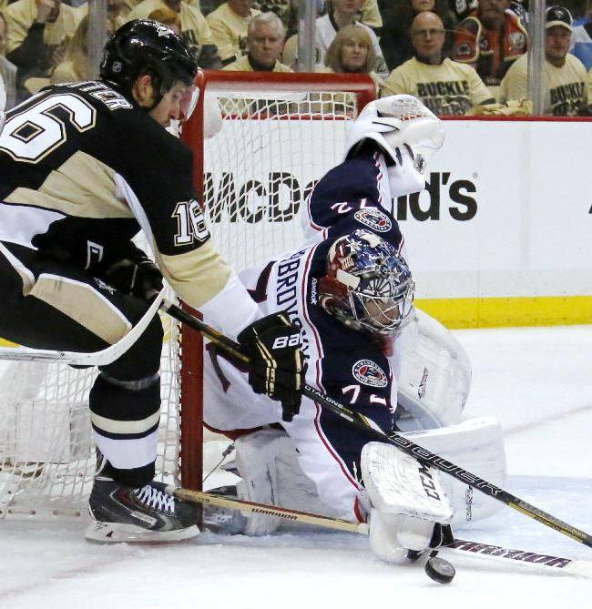 Pittsburgh Penguins' Brandon Sutter (16) can't get a shot past Columbus Blue Jackets goalie Sergei Bobrovsky (72) during the second period of a first-round NHL playoff hockey game in Pittsburgh on Wednesday, April 16, 2014