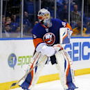 New York Islanders goalie Rick DiPietro (39) comes out of the net to clear the puck during the first period of an NHL hockey game against the Carolina Hurricanes at the Nassau Coliseum in Uniondale, N.Y., Monday, Feb.11, 2013. (AP Photo/Paul J. Bereswill)