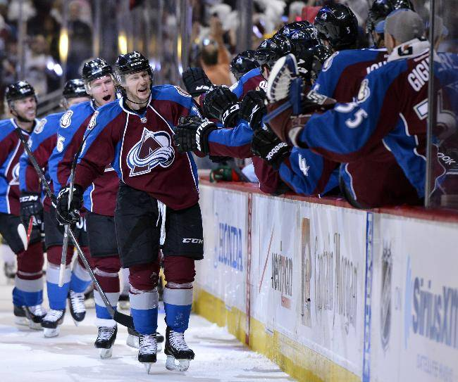 Colorado Avalanche center Nathan MacKinnon (29) celebrates a goal against the Minnesota Wild in the first period of Game 2 of an NHL hockey first-round playoff series on Saturday, April 19, 2014, in Denver