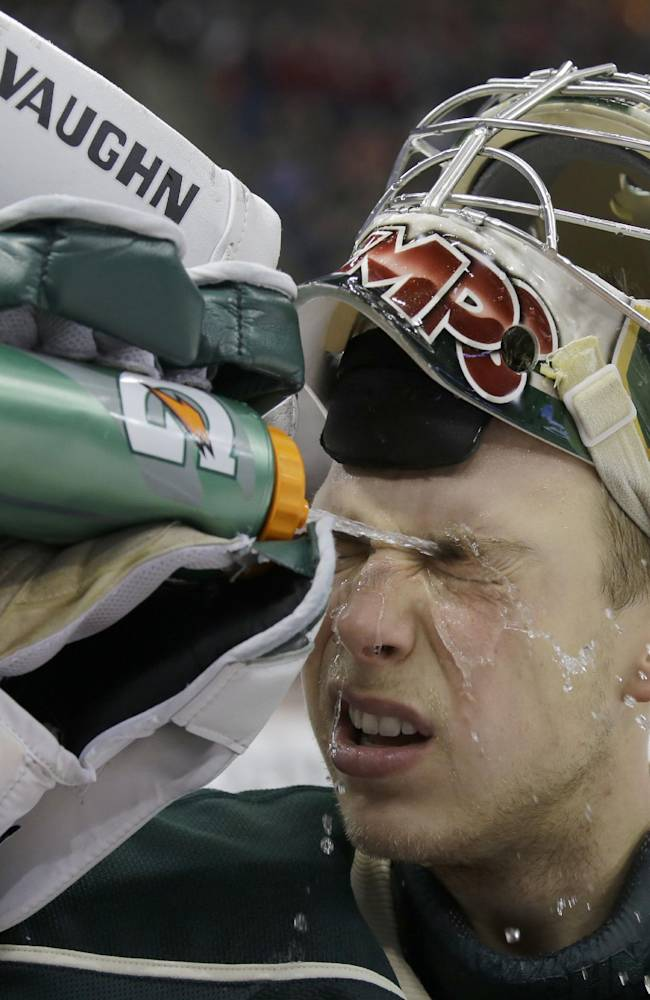 Minnesota Wild goalie Darcy Kuemper sprays water on his face during a timeout during the second period of an NHL hockey game against the Dallas Stars in St. Paul, Minn., Saturday, Jan. 18, 2014. Kuemper stopped 33 shots as the Wild beat the Stars 3-2 in overtime