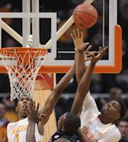 Tennessee guards Josh Richardson (1) and Armani Moore stop a shot attempt by Mississippi center Dwight Coleby during the first half of an NCAA college basketball game Wednesday, Jan. 29, 2014, in Knoxville, Tenn. (AP Photo/Knoxville News Sentinel, Adam Lau)
