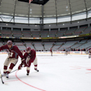 Vancouver Canucks' Tom Sestito, left, and Ryan Kesler battle for the puck during practice for the NHL Heritage Classic hockey game in Vancouver, British Columbia, on Saturday, March 1, 2014. The Canucks are scheduled to play the Ottawa Senators on Sunday