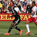 D.C. United forward Eddie Johnson (7) scores a goal in front of New York Red Bulls defender Roy Miller (7) during the second half of an MLS soccer match, at RFK Stadium, Sunday, Aug. 31, 2014, in Washington. United won 2-0 The Associated Press