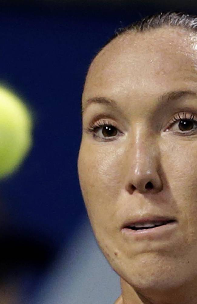 Serbia's Jelena Jankovic prepares to return a shot against Eugenie Bouchard of Canada during their third round match of the Pan Pacific Open tennis tournament in Tokyo, Wednesday, Sept. 25, 2013