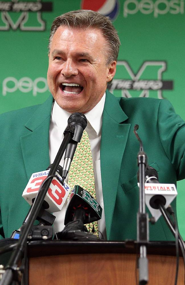 New Marshall University head basketball coach Dan D'Antoni gestures during an introductory news conference Friday, April 25, 2014, at the Marshall University Memorial Student Center in Huntington, W.Va