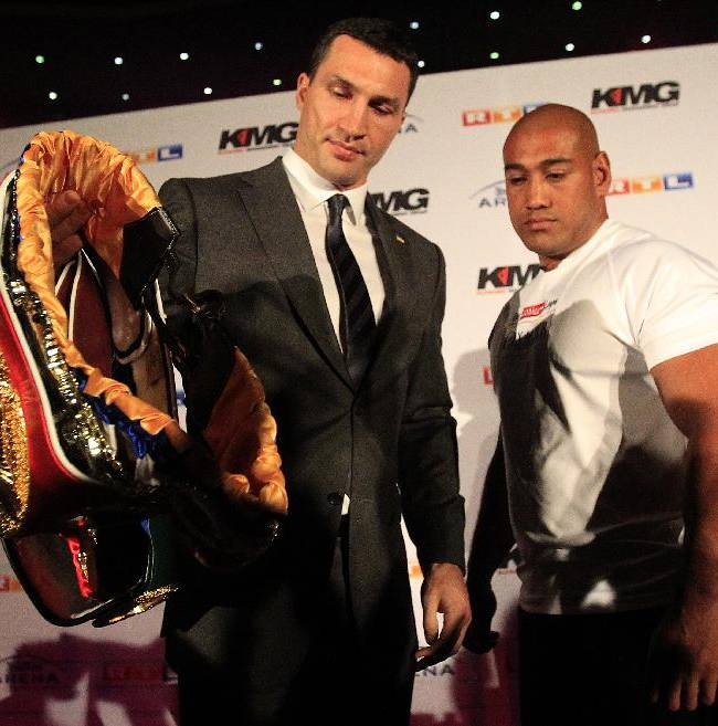 Wladimir Klitschko, left, carries his belts  as Alex Leapai looks on during a press conference ahead of the IBF, IBO, WBO and WBA heavyweight  title bout on April 26, 2014 between Wladimir Klitschko of Ukraine and Alex Leapai of Australia in Oberhausen, Germany, Tuesday, Feb. 11, 2014.( AP Photo/Frank Augstein)