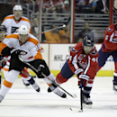 Washington Capitals' Brooks Orpik (44) and Philadelphia Flyers' R.J. Umberger (18) battle for the puck during the second period of a preseason NHL hockey game, Thursday, Oct. 2, 2014, in Washington. The Capitals won 3-2 in a shootout The Associated Press