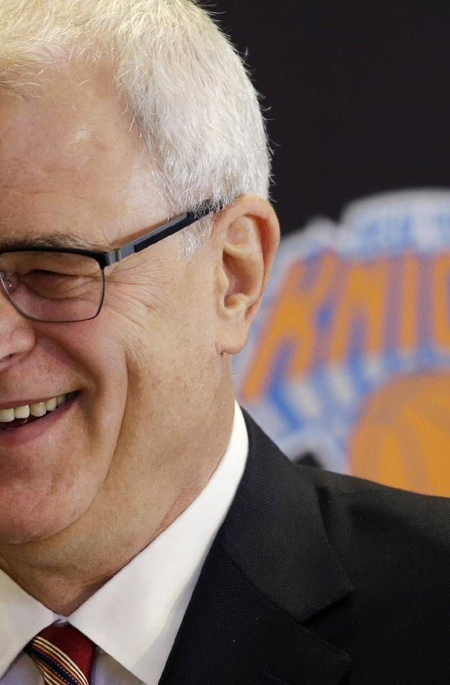 Phil Jackson smiles as he is introduced as the new president of the New York Knicks, Tuesday, March 18, 2014 in New York. Jackson, who won two NBA titles as a player with the Knicks, also won 11 championships while coaching the Chicago Bulls and the Los Angeles Lakers