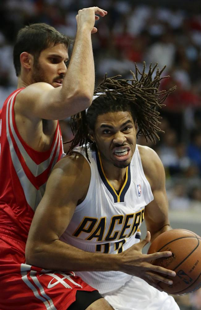 Indiana Pacers' Chris Copeland drives to the basket as Houston Rockets' Omri Casspi, left, defends during their NBA  pre-season game dubbed NBA Global Games Thursday Oct. 10, 2013, at the Mall of Asia Arena at suburban Pasay city, south of Manila, Philippines. The Rockets won 116-96, in the first NBA game in this basketball-crazy Southeast Asian nation which is part of the NBA's global schedule that will have eight teams play in six countries this month