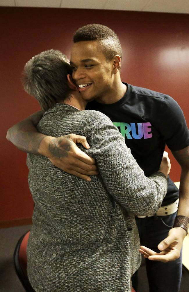 University of Massachusetts basketball guard Derrick Gordon hugs UMass professor emeritus Pat Griffin after speaking to reporters on the school's campus, Wednesday, April 9, 2014, in Amherst, Mass. Gordon has become the first openly gay player in Division I men's basketball. Griffin teaches lesbian, gay, bisexual, and transgender issues
